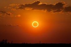 Mid-eclipse, perfectly centered ring of fire.